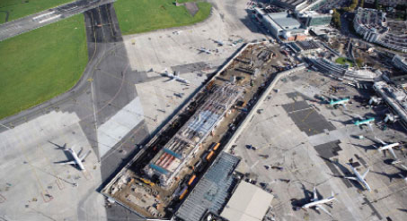Pier D was built to facilitate fast turnarounds. The 5120 million facility has 12 boarding gates and parking for up to 14 aircraft. It is linked to the existing terminal via an elevated Skybridge.