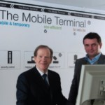 Robert Deillon, Geneva Airport's general director, and Thomas Melcher, managing director and inventor of TMT The Mobile Terminal, at the official opening of the first TMT facility at Geneva International Airport.
