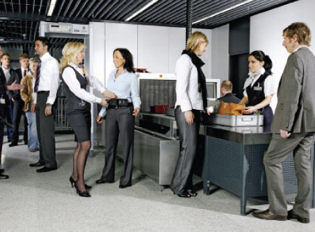 Passengers passing through airport security.