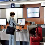 At Montral-Trudeau Airport, Westjet passengers can use kiosks to check-in and print their baggage tags before dropping their bag at a dedicated counter.