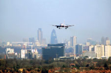 An aeroplane flying over London.