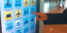 A number of airports have recently installed interactive kiosks, such as the one pictured at Barcelona Airport.