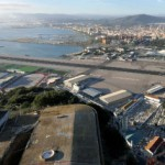 Due to a limited amount of flat land on the peninsula, GIB's runway is bisected by the main artery of highway traffic that goes in and out of Gibraltar.
