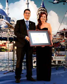 "Pictured at the certification ceremony of Enfidha-Hammamet International Airport are Mr. Ali Tounsi (Secretary General, ACI AFRICA) presenting the ""Mapping"" certificate to Ms. Eda Bildiricioglu (Operations Services Manager, TAV)."