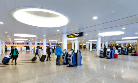 Self-service check-in kiosks at Copenhagen Airport.